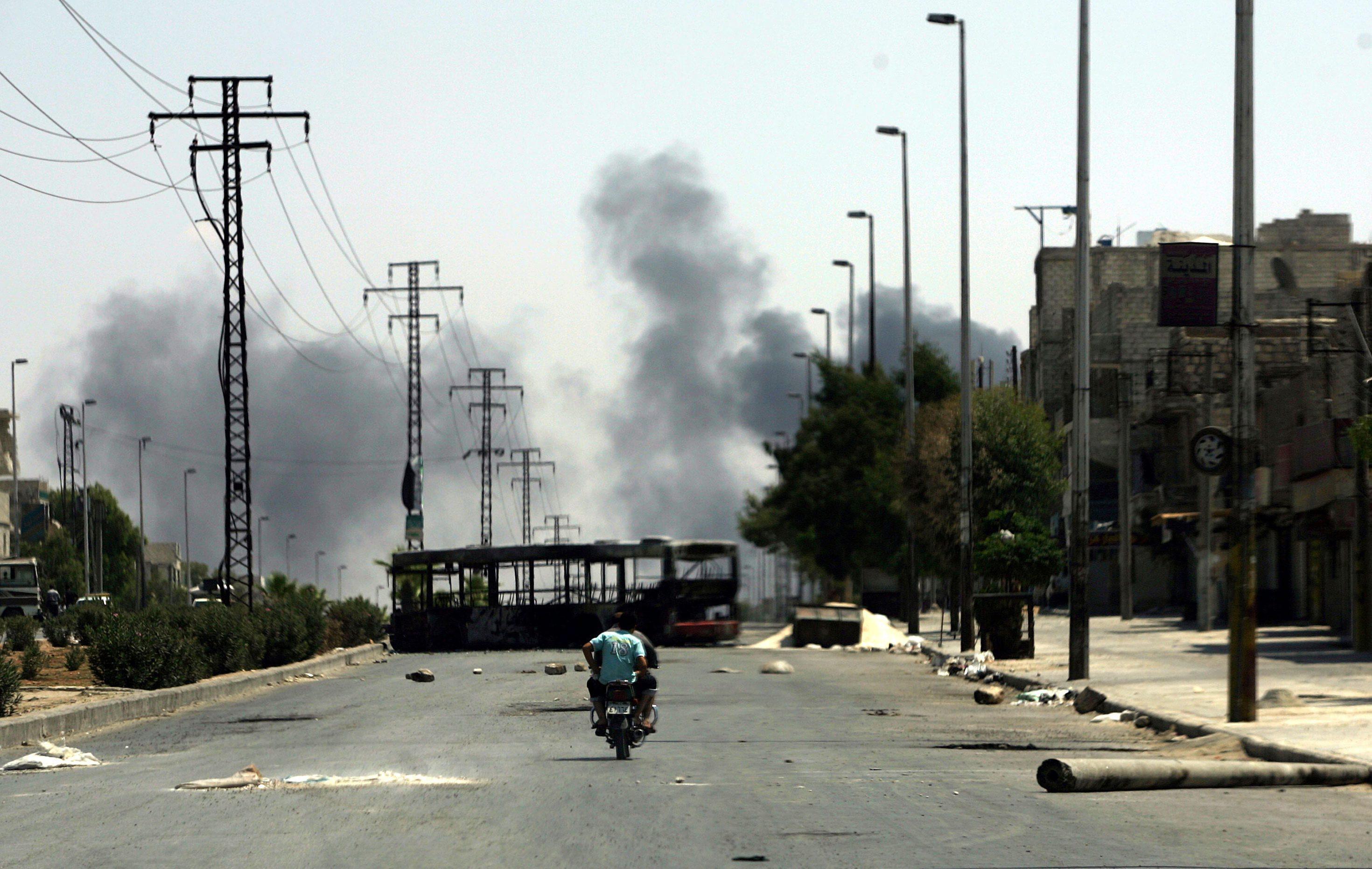 Syrian rebels patrol streets near Aleppo