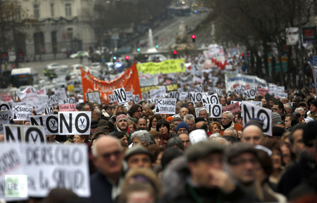 Health workers and supporters take part in a protest against the local government's plans to cut spending on public health care in Madrid